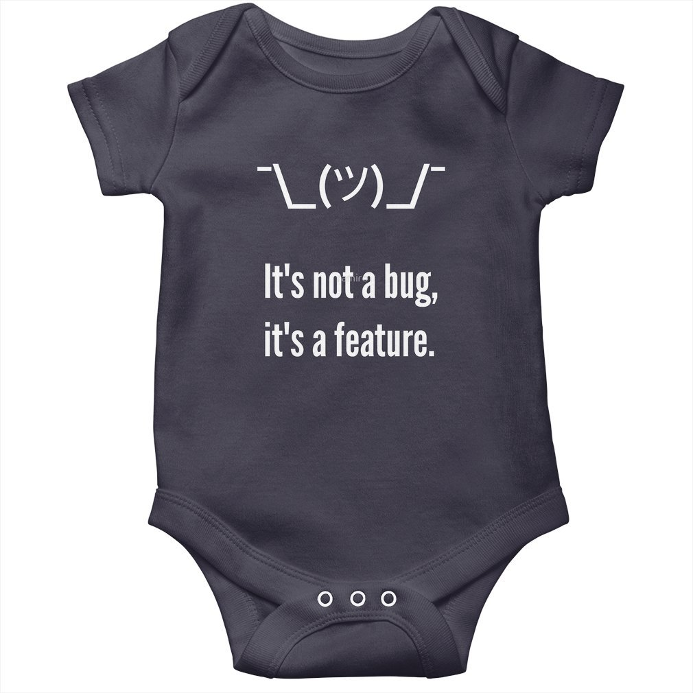 Thumb Shrug It is not a bug, it's a feature. White Text Programmer Excuse Design Baby Onesie